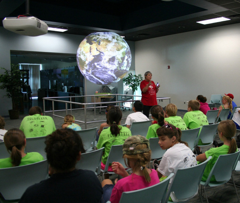 Children from Sea Camp attending a Science on a Sphere program