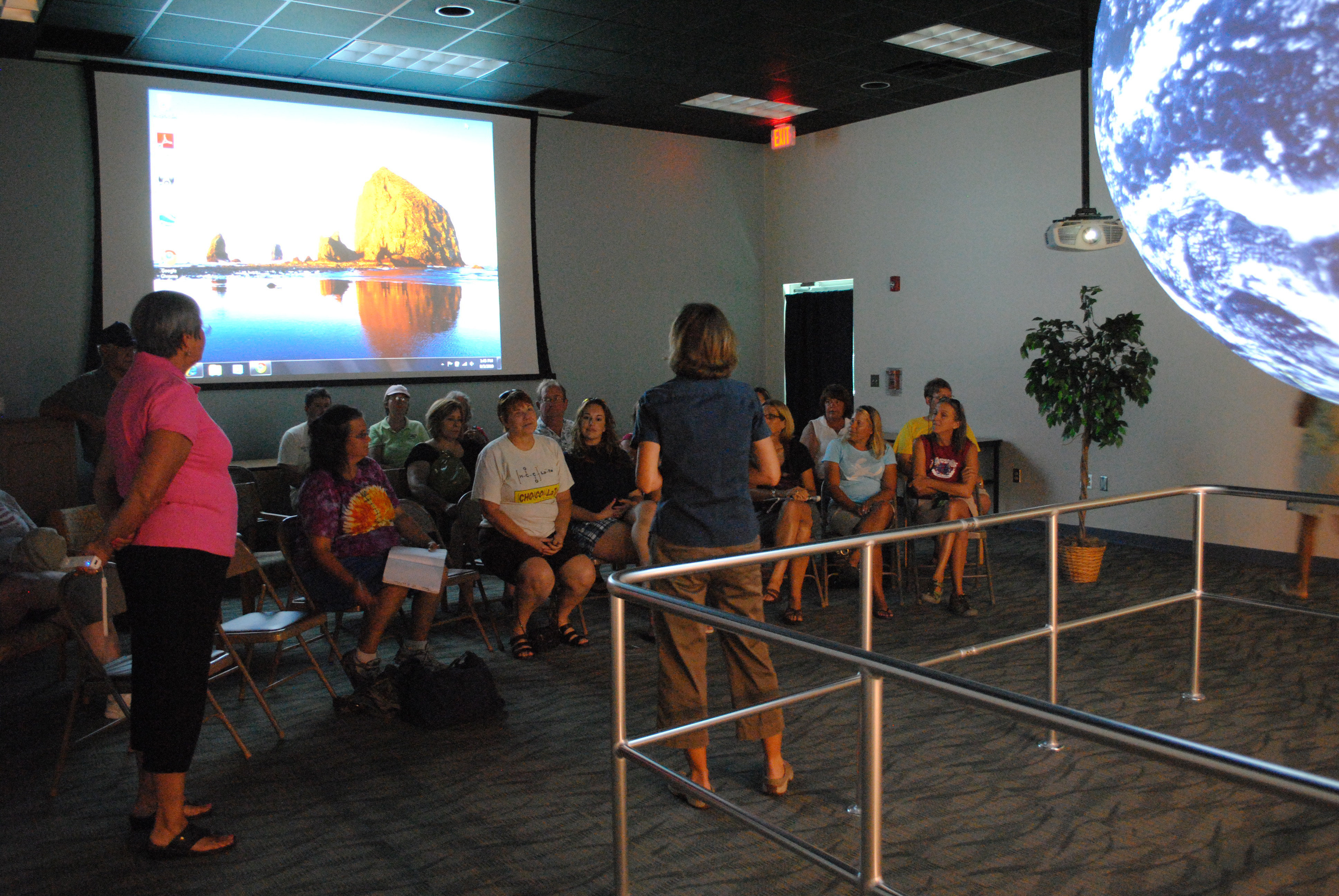 K-12 educators learning about the teaching potential of Science on a Sphere