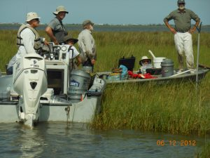 L-R: After completion of sampling at one site on Terrebonne Bay, Jim Lee (LSU), Olaf Jensen (Rutgers), Paola Lopez-Duarte (Rutgers), Ken Able (Rutgers), Erick Swenson (LSU), and Gene Turner (LSU) discuss the next sample location. (Photo credit: Tiffany Warner, LUMCON)