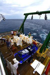 Members of the CARTHE team stage drifters on the RV Walton Smith. (Photo credit: Tamay Özgökmen, University of Miami)