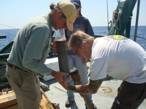 Dr. Jeff Chanton and graduate student Brian Wells (FSU) remove a sediment core from the bottom of the Gulf. RV Weatherbird II (Photo credit: Beth Huettel, FSU)