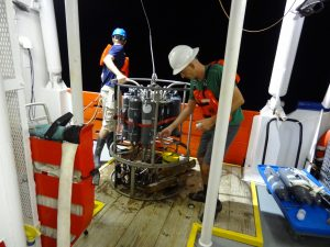 FSU oceanographer Dr. Nico Wienders works during the night to prepare a CTD cast. Water samples will provide data on temperature, salinity, oxygen, and pressure. RV Pelican (Photo credit: Kevin Speer, FSU)
