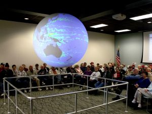General public visitors attend a Science on a Sphere presentation at the Bay Education Center. (Photo by Jackie Hattenbach)