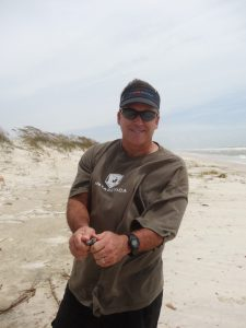 Dr. Wade Jeffrey, University of West Florida, participated in a post-Hurricane Isaac field operation to collect samples on the beaches of Gulf Shores, AL (August 30, 2012). (Photo credit: Camilo Ponton, WHOI)