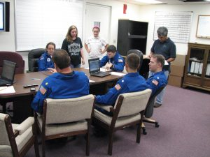 UM team during a pre-flight briefing with NOAA's flight crew at MacDill Air Force Base. Photo credit: Jodi Brewster.