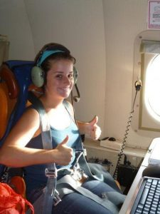 Second-year University of Miami Meteorology & Physical Oceanography student Ryan Schuster gives the thumbs up in NOAA's P-3 aircraft as she and a team of researchers take off to to drop profilers into Hurricane Isaac and collect measurements of ocean heat content, salinity and currents in the Gulf of Mexico as part of the Deep-C initiative. (Credit: Jodi Brewster)