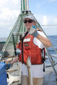 Dean Dixon holds a king snake eel. She blogged about her experiences on the RV Weatherbird II. (Photo credit: C-IMAGE)