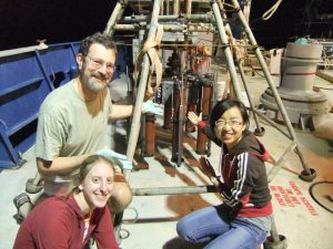 Tingting Yang, Lisa Nigro, and Andreas Teske, onboard RV Atlantis in November 2010 with a freshly retieved full multicorer of Gulf of Mexico sediment.
