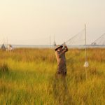 Scientists set up nets to collect Seaside Sparrows as part of a study on the impacts of oil on land-based animals in Louisiana marshes. (Photo credit: Phil Stouffer)