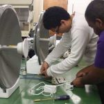 Engineering students work on radar antennas for their project to design and implement a laboratory scale directional radar system. This system can help determine oil density and calibrate the Synthetic Aperture Radar. Team members (L-R) are Jonathan Logan, Juan Alverez, and Roman Cooks. Not pictured is Drew Hale. (Photo credit: Diana Villa)