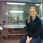 High school sophomore Elizabeth Smithwick during a visit to the Kostka Lab at Georgia Tech is seated in front of a biohood used for the preparation of culture media. (Photo credit: Joel Kostka)
