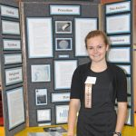 High school sophomore Elizabeth Smithwick stands next to her regional science fair project that won first place. (Photo provided by Elizabeth Smithwick)