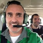 Scientists Chris Reddy (foreground) and Dave Valentine on an overflight in January 2013. (Credit: Chris Reddy, WHOI)