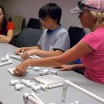 """Mothers and sons worked together as """"engineers"""" to build frames for ROVs. (Photo by Murt Conover)"""