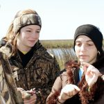 Dad and daughters Jordan and Kristen Brunet discovered salt marsh periwinkles. The Periwinkle is a resident snail in the salt marshes that surround the DeFelice Marine Center in Cocodrie, LA. (Photo by Murt Conover)