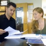 """Intern Lauren """"Ren"""" Reilly (R) and her mentor Dr. Patrick Schwing comb through data together in the paleoclimatology lab at the University of South Florida. (Photo courtesy of Deep-C)"""